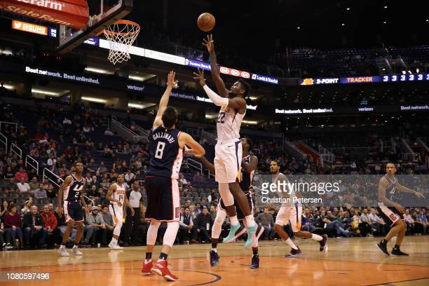 Deandre Ayton of the Phoenix Suns attempts a shot over Danilo Gallinari of the LA Clippers during overtime of the NBA game at Talking Stick Resort...