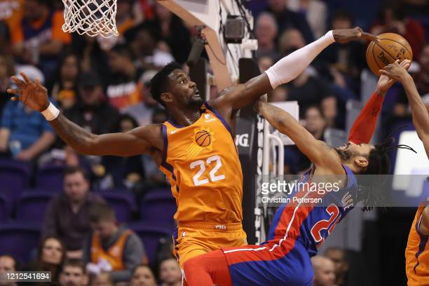 Deandre Ayton of the Phoenix Suns blocks a shot from Derrick Rose of the Detroit Pistons during the second half of the NBA game at Talking Stick...