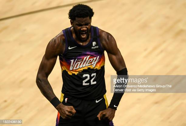 Deandre Ayton of the Phoenix Suns celebrates making a shot and drawing a foul against the Denver Nuggets during the third quarter at Phoenix Suns...
