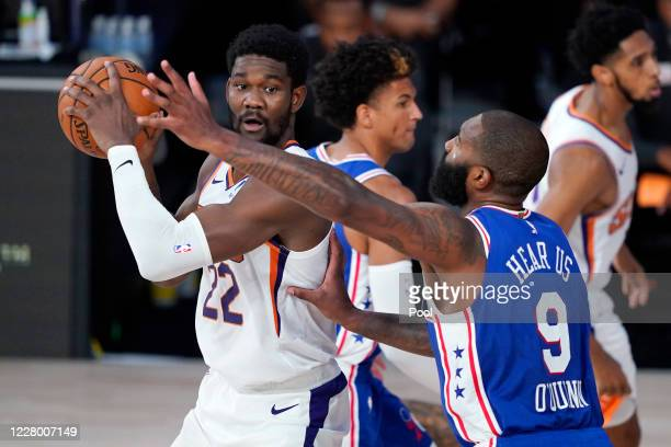 Deandre Ayton of the Phoenix Suns controls the ball against Kyle O'Quinn of the Philadelphia 76ers during the second half of an NBA basketball game...