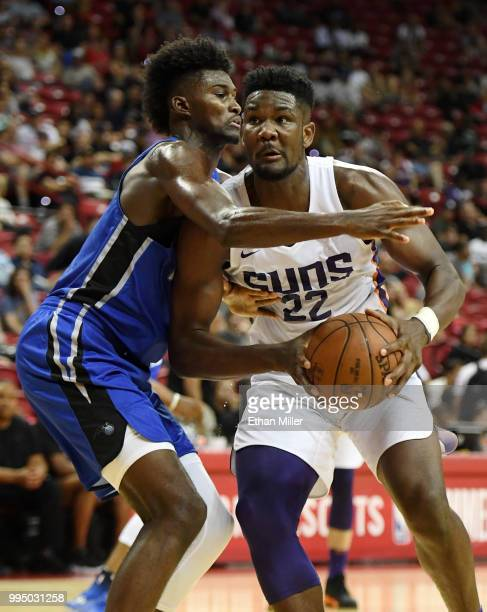 Deandre Ayton of the Phoenix Suns drives against Jonathan Isaac of the Orlando Magic during the 2018 NBA Summer League at the Thomas Mack Center on...