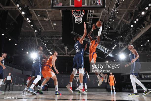 Deandre Ayton of the Phoenix Suns drives to the basket against the Dallas Mavericks on August 13 2020 at AdventHealth Arena in Orlando Florida NOTE...