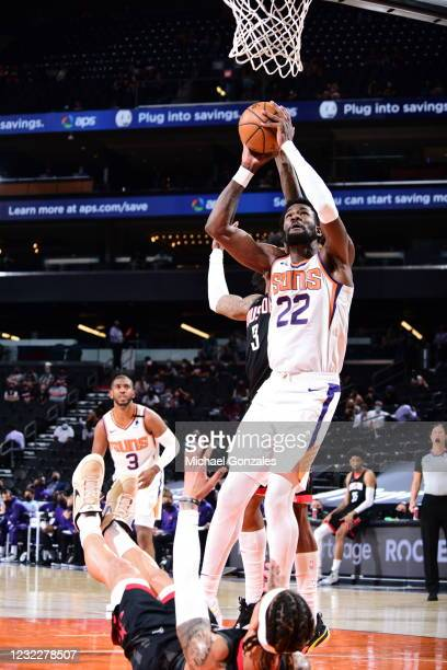 Deandre Ayton of the Phoenix Suns drives to the basket during the game against the Houston Rockets on April 12, 2021 at Phoenix Suns Arena in...