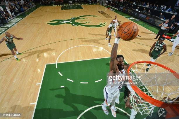 Deandre Ayton of the Phoenix Suns dunks the ball against the Milwaukee Bucks during Game Three of the 2021 NBA Finals on July 11, 2021 at Fiserv...