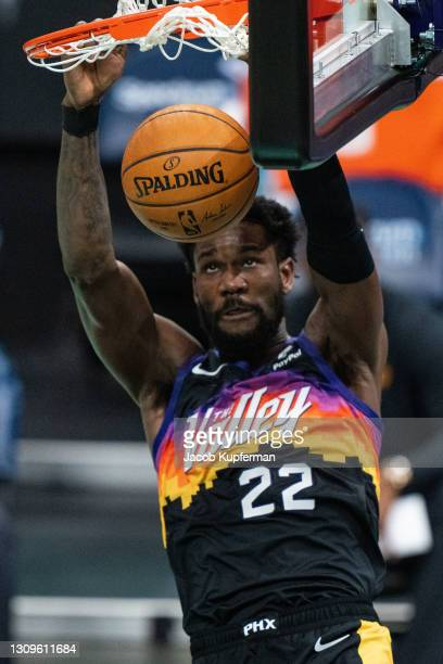 Deandre Ayton of the Phoenix Suns dunks the ball against the Charlotte Hornets during the third quarter during their game at Spectrum Center on March...