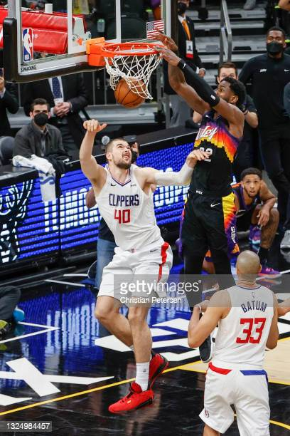 Deandre Ayton of the Phoenix Suns dunks the ball over Ivica Zubac of the LA Clippers during the fourth quarter in game two of the NBA Western...