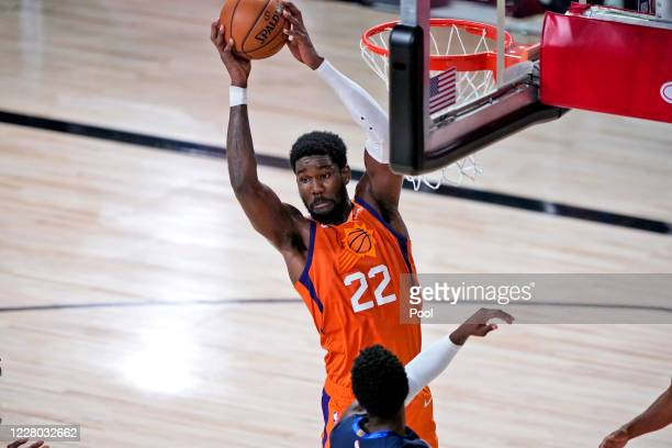 Deandre Ayton of the Phoenix Suns grabs the ball during the first half of an NBA basketball game against the Dallas Mavericks at AdventHealth Arena...