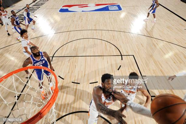 Deandre Ayton of the Phoenix Suns grabs the rebound against the Philadelphia 76ers on August 11 2020 at Visa Athletic Center at ESPN Wide World of...
