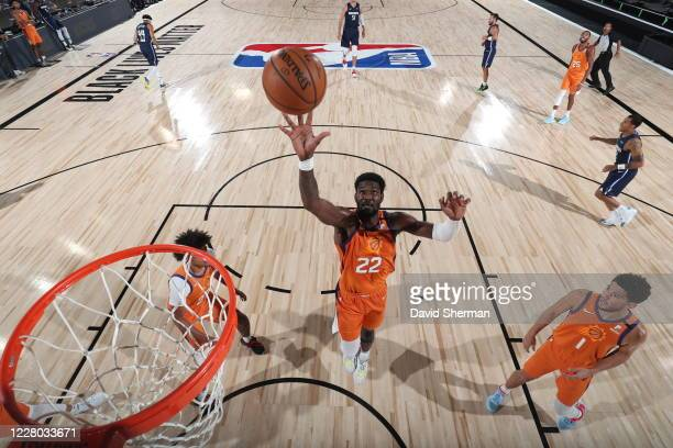 Deandre Ayton of the Phoenix Suns grabs the rebound against the Dallas Mavericks on August 13 2020 at AdventHealth Arena in Orlando Florida NOTE TO...