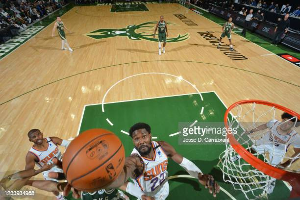 Deandre Ayton of the Phoenix Suns grabs the rebound against the Milwaukee Bucks during Game Three of the 2021 NBA Finals on July 11, 2021 at Fiserv...