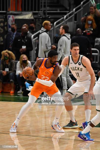 Deandre Ayton of the Phoenix Suns handles the ball against the Milwaukee Bucks during Game Four of the 2021 NBA Finals on July 14, 2021 at Fiserv...