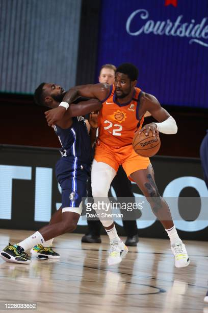 Deandre Ayton of the Phoenix Suns handles the ball against the Dallas Mavericks on August 13 2020 at AdventHealth Arena in Orlando Florida NOTE TO...