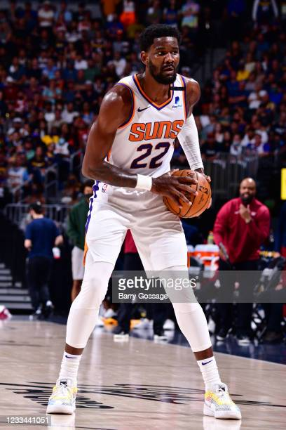 Deandre Ayton of the Phoenix Suns handles the ball during Round 2, Game 4 of the 2021 NBA Playoffs on June 13, 2021 at the Ball Arena in Denver,...