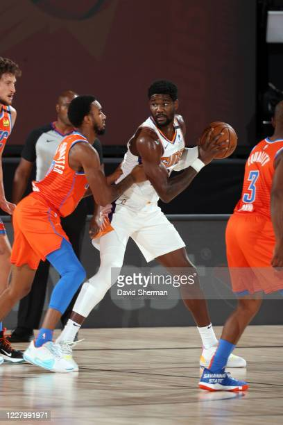 Deandre Ayton of the Phoenix Suns handles the ball during the game against the Oklahoma City Thunder on August 10 2020 at The Field House at ESPN...
