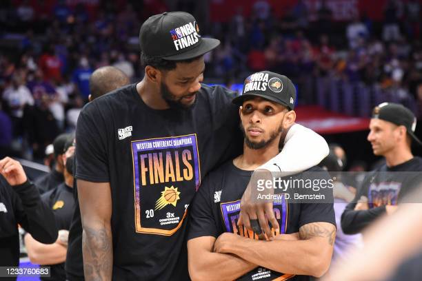 Deandre Ayton of the Phoenix Suns hugs Cameron Payne of the Phoenix Suns after the game against the LA Clippers during Game 6 of the Western...