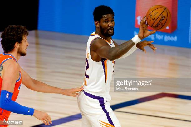 Deandre Ayton of the Phoenix Suns looks to pass against the Oklahoma City Thunder during the second quarter at The Field House at ESPN Wide World Of...