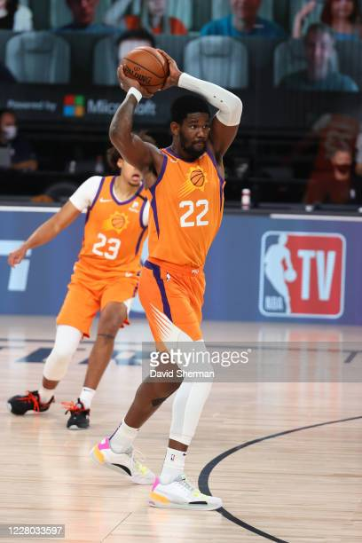 Deandre Ayton of the Phoenix Suns looks to pass the ball against the Dallas Mavericks on August 13 2020 at AdventHealth Arena in Orlando Florida NOTE...