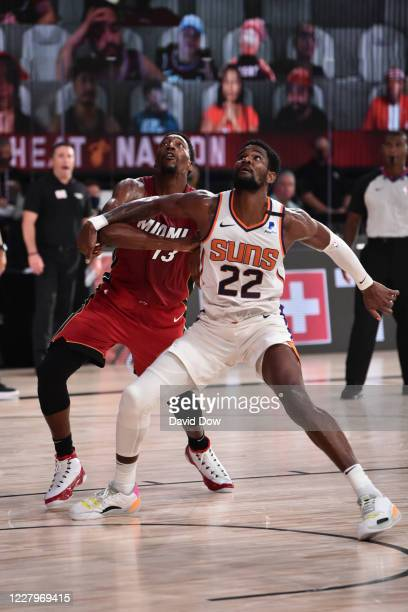 Deandre Ayton of the Phoenix Suns plays defense against the Miami Heat on August 8 2020 at Visa Athletic Center at ESPN Wide World of Sports in...