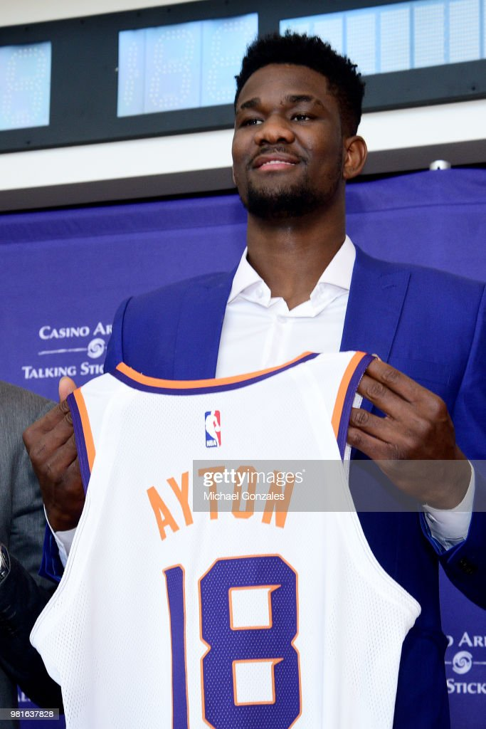 purchase cheap 4bf5a ad679 DeAndre Ayton of the Phoenix Suns poses with his jersey ...