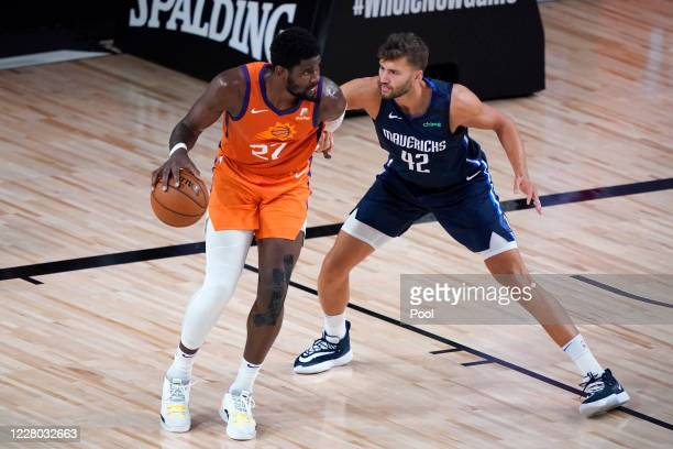 Deandre Ayton of the Phoenix Suns posts up against Maxi Kleber of the Dallas Mavericks in the first half at AdventHealth Arena at ESPN Wide World Of...