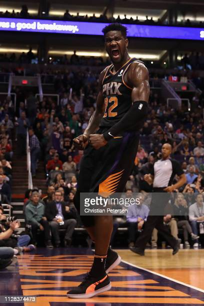 Deandre Ayton of the Phoenix Suns reacts after a slam dunk against the Golden State Warriors during the second half of the NBA game at Talking Stick...