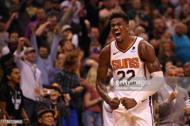Deandre Ayton of the Phoenix Suns reacts during the final moments of the NBA game against the Milwaukee Bucks at Talking Stick Resort Arena on March...