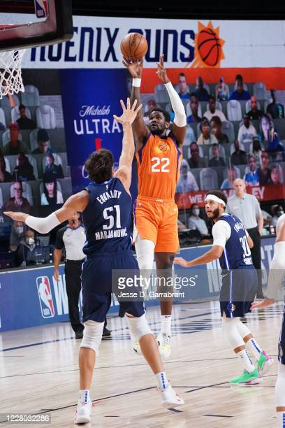 Deandre Ayton of the Phoenix Suns shoots the ball against the Dallas Mavericks on August 13 2020 at AdventHealth Arena in Orlando Florida NOTE TO...