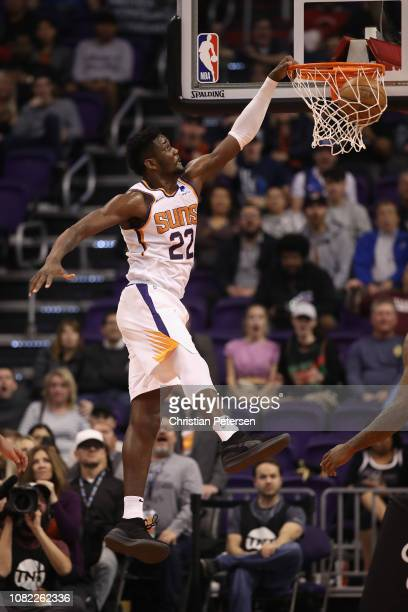 Deandre Ayton of the Phoenix Suns slam dunks the ball against the Dallas Mavericks during the first half of the NBA game at Talking Stick Resort...