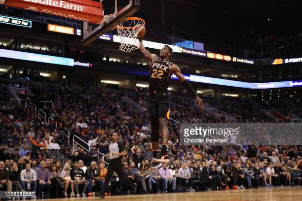 Deandre Ayton of the Phoenix Suns slam dunks the ball against the Golden State Warriors during the second half of the NBA game at Talking Stick...