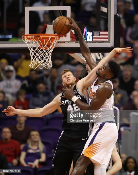 Deandre Ayton of the Phoenix Suns slam dunks the ball over Davis Bertans of the San Antonio Spurs during the second half of the NBA game at Talking...