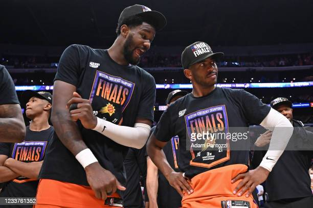 Deandre Ayton of the Phoenix Suns talks to Chris Paul of the Phoenix Suns after the game against the LA Clippers during Game 6 of the Western...
