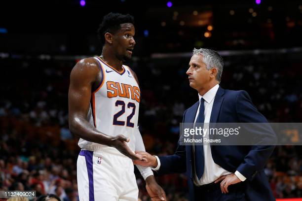 Deandre Ayton of the Phoenix Suns talks with head coach Igor Kokoskov against the Miami Heat during the first half at American Airlines Arena on...