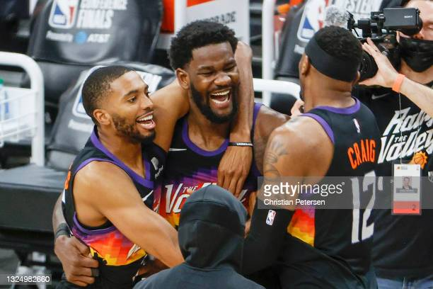 Deandre Ayton of the Phoenix Suns, Torrey Craig, and Mikal Bridges celebrate defeating the LA Clippers 104-103 in game two of the NBA Western...