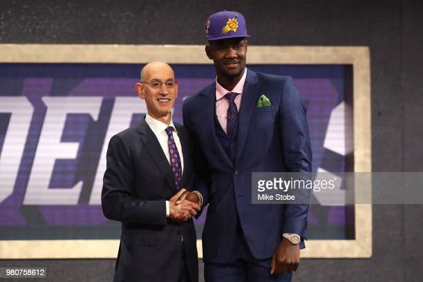 Deandre Ayton poses with NBA Commissioner Adam Silver after being drafted first overall by the Phoenix Suns during the 2018 NBA Draft at the Barclays...