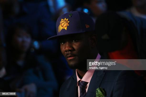 DeAndre Ayton puts on the Phoenix Suns 2018 NBA Draft hat after being drafted first overall by the Phoenix Suns during the 2018 NBA Draft at the...