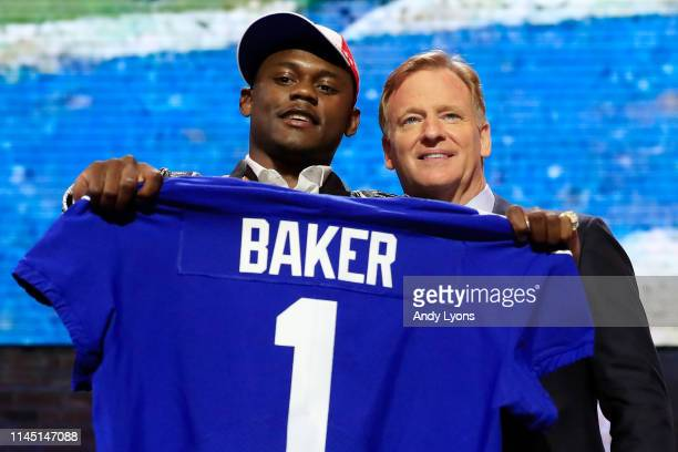 Deandre Baker of Georgia poses with NFL Commissioner Roger Goodell after being chosen overall by the New York Giants during the first round of the...