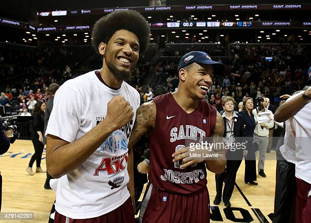 DeAndre Bembry and Chris Wilson of the Saint Joseph's Hawks celebrate after defeating the Virginia Commonwealth Rams during the Championship game of...