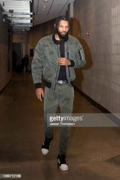 DeAndre' Bembry of the Atlanta Hawks arrives before the game against the Charlotte Hornets on February 9 2019 at State Farm Arena in Atlanta Georgia...