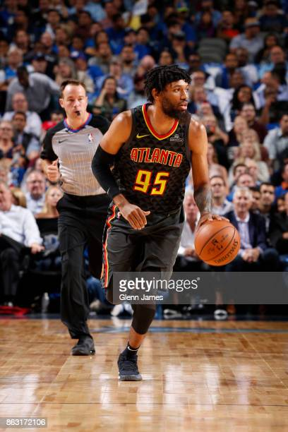 DeAndre' Bembry of the Atlanta Hawks dribbles the ball against the Dallas Mavericks at the American Airlines Center in Dallas Texas on October 18...