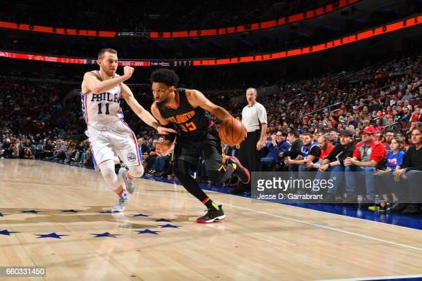 DeAndre' Bembry of the Atlanta Hawks drives to the basket against the Philadelphia 76ers at Wells Fargo Center on March 29 2017 in Philadelphia...