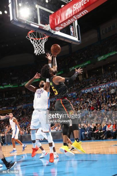 DeAndre' Bembry of the Atlanta Hawks dunks against the Oklahoma City Thunder on December 22 2017 at Chesapeake Energy Arena in Oklahoma City Oklahoma...