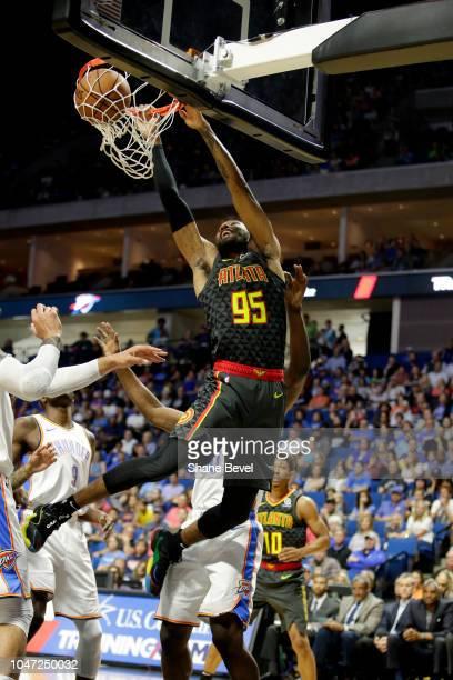 DeAndre' Bembry of the Atlanta Hawks dunks the ball against Oklahoma City Thunder during a preseason game on October 7 2018 at BOK Center in Tulsa...