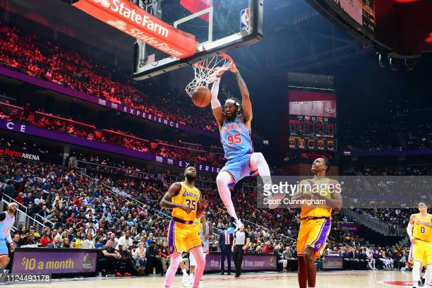 DeAndre' Bembry of the Atlanta Hawks dunks the ball against the Los Angeles Lakers on February 12 2019 at State Farm Arena in Atlanta Georgia NOTE TO...