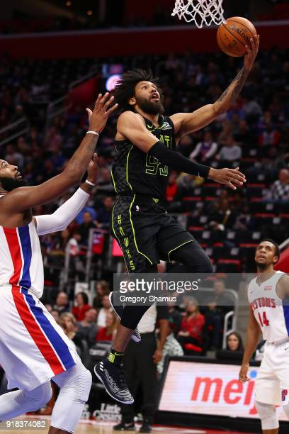 DeAndre' Bembry of the Atlanta Hawks gets to the basset past Andre Drummond of the Detroit Pistons during the second half at Little Caesars Arena on...