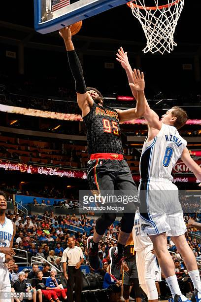 DeAndre Bembry of the Atlanta Hawks goes up for a lay up against Mario Hezonja of the Orlando Magic during a preseason game on October 16 2016 at...