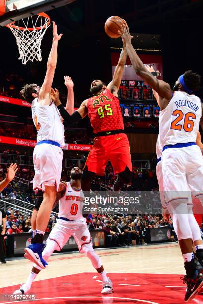 DeAndre' Bembry of the Atlanta Hawks goes up for contested dunk against the New York Knicks on February 14 2019 at State Farm Arena in Atlanta...