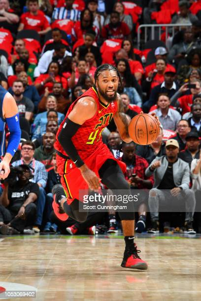 DeAndre' Bembry of the Atlanta Hawks handles the ball against the Dallas Mavericks on October 24 2018 at State Farm Arena in Atlanta Georgia NOTE TO...