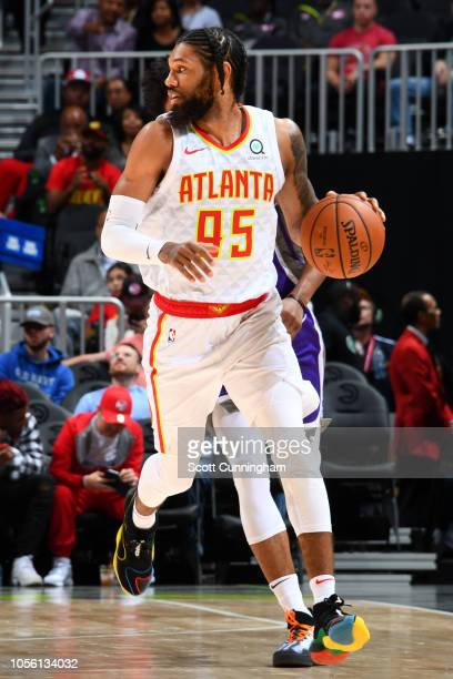 DeAndre' Bembry of the Atlanta Hawks handles the ball against the Sacramento Kings on November 1 2018 at State Farm Arena in Atlanta Georgia NOTE TO...