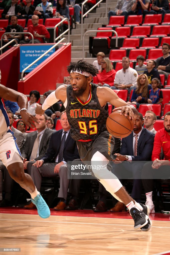 DeAndre' Bembry #95 of the Atlanta Hawks handles the ball against the Detroit Pistons on October 6, 2017 at Little Caesars Arena in Detroit, Michigan.