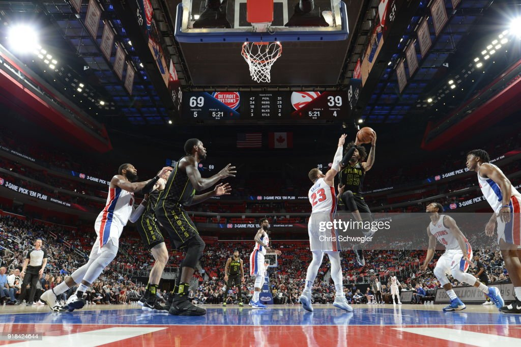 DeAndre' Bembry #95 of the Atlanta Hawks handles the ball against the Detroit Pistons on February 14, 2018 at Little Caesars Arena in Detroit, Michigan.